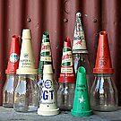Old oil bottles by Julie Sherlock
