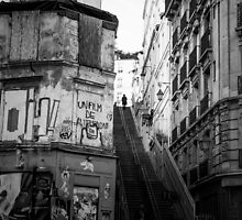 Woman reaching the top of the stairs (Montmartre, Paris) by Olivier Sohn