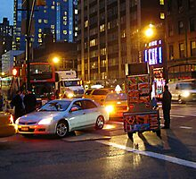 A NYC Traffic Jam at night including a food vendor cart... by Jane Neill-Hancock