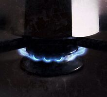 Blue flame under moka coffee maker by Luigi Masella