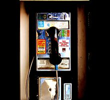 Zoom out Mexican public payphone by Johnny Sunardi