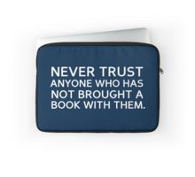 never trust anyone who has not brought a book with them - quote Laptop Sleeve