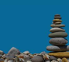 pebble stack against blue background by Graham McAndrew