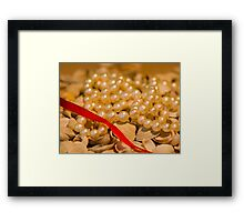 Red ribbon and pearls Framed Print