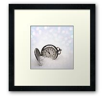 Watch lying in the snow Framed Print