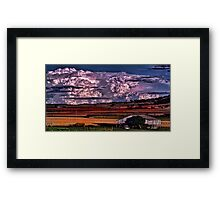 Storm clouds and country sheds Framed Print