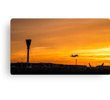 Heathrow airport at sunset Canvas Print