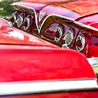 Two Red Chevy Impalas with Lights by studiojanney