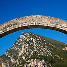 Plaka bridge flying over the Tzoumerka mountains by Hercules Milas