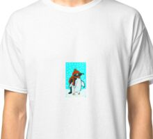Charlie, the penguin. Chilling in the snow.  Classic T-Shirt