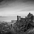 Ireland Panorama BW - Dunluce Castle by lesslinear