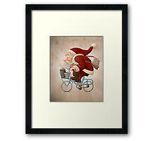 Santa Claus rides a bicycle Framed Print