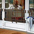 Umbrellas at the door by Arie Koene