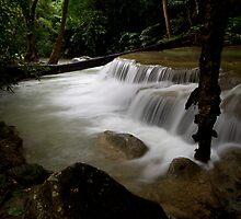 Waterfall with stream in Erawan by Kenji Ashman
