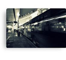 Waiting for the night bus in the dark city street Canvas Print