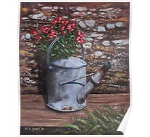 Old watering can with flowers by stone wall Poster