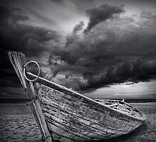 Boat with Storm Brewing by Randall Nyhof