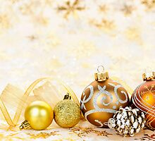 Golden Christmas ornaments background by Elena Elisseeva