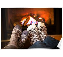 Feet warming by fireplace Poster