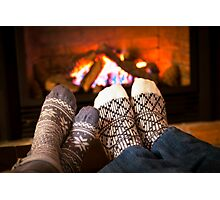 Feet warming by fireplace Photographic Print