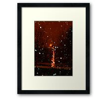 Snow And Lights Aglow Framed Print
