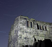 Star trails over a ruined farm  by fotohebden