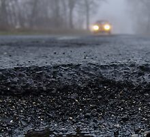 Asphalt`s holes on roadbed by Tom Klausz