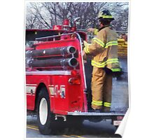 Fireman on Back of Fire Truck Poster
