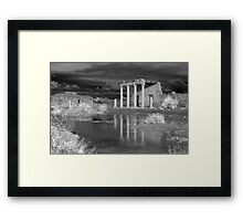 Storm clouds over ancient greek ruins Framed Print
