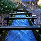 Water rushing down millrace towards historical Mingus Mill by Terri~Lynn Bealle