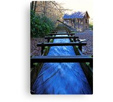 Water rushing down millrace towards historical Mingus Mill Canvas Print