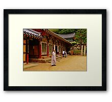 Korean Monk on Cell Phone Framed Print