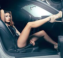 Sexy Young Woman Sitting in a Car art photo print by ArtNudePhotos