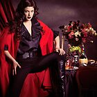 Beautiful woman in red coat in front of festive table art photo print by ArtNudePhotos