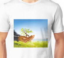 Hands holding a tree Unisex T-Shirt