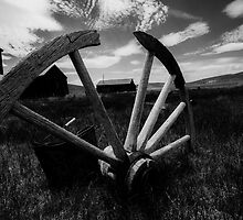 Black and white - Abandoned old wagon wheel by Jerome Obille