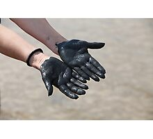 hands in black mud Photographic Print