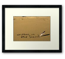 written in the sand with feather quill Framed Print