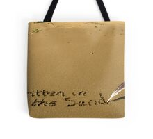 written in the sand with feather quill Tote Bag