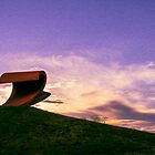 Sunset over the wave sculpture by Peter Gray