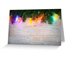 Christmas background with lights on branches Greeting Card