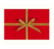 Red gift with gold ribbon Art Print