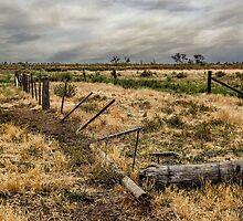 The broken fence by Skyangel