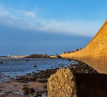 Burghead beach wall. by JASPERIMAGE