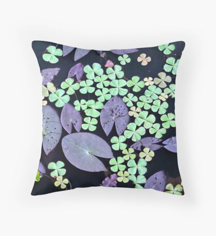 Sprinkled leaves on a pond Throw Pillow