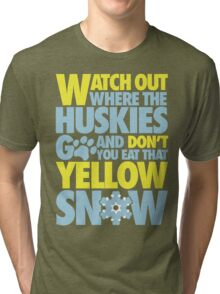 Watch out where the huskies go and don't you eat that yellow snow! Tri-blend T-Shirt