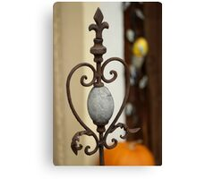 Iron sculpture and stone Canvas Print