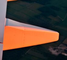 Sun painting the wing red Sticker