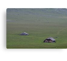 Isolated farm in the Swiss mountains. Canvas Print
