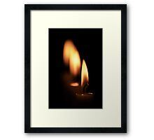 Four candles Framed Print